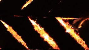 Sound. Night crickets and burning sounds for twenty seconds. Extreme close-up video of a burning picnic bench. Summer holidays fun. Night crickets and burning stock footage