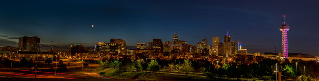 Night Denver skyline with crescent moon and blue sky Royalty Free Stock Images