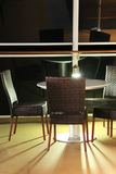 Night dining. Table and chairs at night on deck of cruise ship Royalty Free Stock Photography