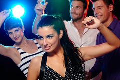 Night in the discotheque. Young people having fun in discotheque, nightclub, dancing, drinking Stock Image