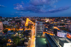 Night in Dnipropetrovsk - skyscrapers and dark river stock image