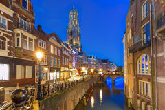Night Dom Tower and bridge, Utrecht, Netherlands. Dom Tower, bridge and canal Oudegracht in the night colorful illuminations in the blue hour, Utrecht Stock Photo