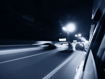 Night drive. Fast car moving in motion on the highway stock photos