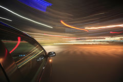 Night drive with car in motion. Stock Photography
