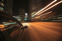 Night drive with car in motion. Royalty Free Stock Image