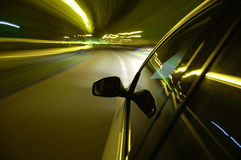 Night drive with car in motion Stock Images