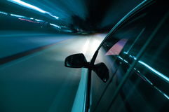 Night drive with car in motion Royalty Free Stock Image