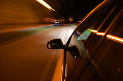 Night drive with car in motion Royalty Free Stock Images