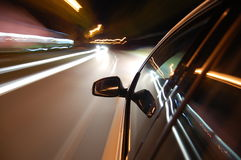 Night drive with car in motion. Through the city shows the speed Royalty Free Stock Images