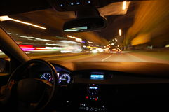 Night drive with car in motion Stock Photo