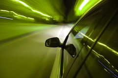 Night drive with car in motion Royalty Free Stock Photography