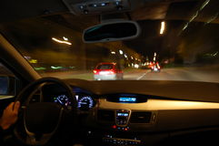 Night drive with car in motion. Through the city shows the speed Royalty Free Stock Image