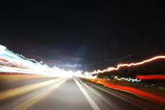 Night driving. This picture was taken by strapping my camera to the handlebars of my motorcycle and driving around town at night. The pictures I take like this Stock Images