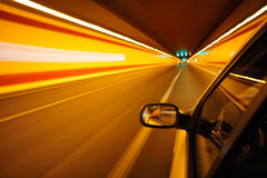 Night driving. Driving through a tunnel by night Royalty Free Stock Photos