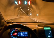 Night driving car and navigation on the phone in tunnel. Road royalty free stock images