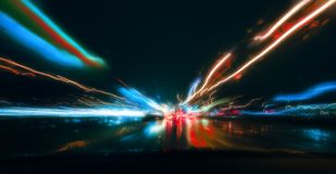 Night driving.Long exposure photo.City colorful night lights perspective blurred by high speed of the car. Night driving.Long exposure photo.City colorful night Stock Photo