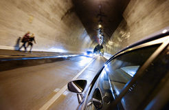Night driving-motion blur tunnel light Stock Images