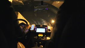 Night driving tunnel lights woman hand on steering wheel. Pov inside car driving tunnel evening stock video