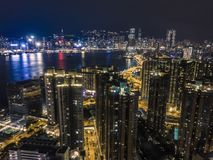 Night drone view of the city by the bay. With lights from the high buildings royalty free stock photography