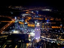 Night Dubai from Burj Khalifa. Night lights of Dubai skyline from Burj Khalifa, showing streets and lights Stock Photo