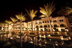 Night Dubai street with palms and pool Royalty Free Stock Photos