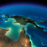 Night Earth. Australia and Papua New Guinea. Highly detailed Earth, illuminated by moonlight. The glow of cities sheds light on the detailed exaggerated terrain Royalty Free Stock Image