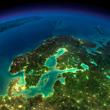 Night Earth. Europe. Scandinavia. Highly detailed Earth, illuminated by moonlight. The glow of cities sheds light on the detailed exaggerated terrain. Night Stock Photo