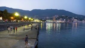 Night Embankment of Yalta, Crimea. TimeLapse. Night Embankment of Yalta, Crimea. Time Lapse. Lanterns illuminate the sidewalk, a crowd of people of tourists stock footage