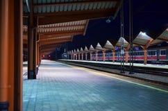 Night empty railway platform. Poland. Przemysl. Night empty railway platform illuminated with artificial lighting Stock Photo