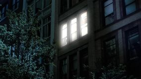 Night Establishing Shot of Office or Apartment Building Lights Turning On Off stock video