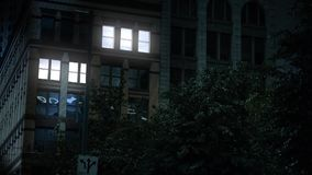 Night Establishing Shot of Office Building Lights Turning On stock footage