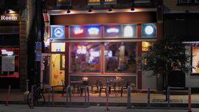 Night Establishing Shot of Typical Bar Restaurant in City stock video footage