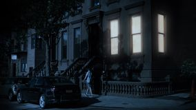 Night Establishing Shot of Typical Brooklyn Brownstone Home. 8728 A nighttime exterior establishing shot of a typical Brooklyn brownstone residential home on a stock video
