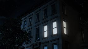 Night Establishing Shot of Typical Brooklyn Brownstone Upper Floors. 8727 A nighttime exterior establishing shot of the upper floors of a typical Brooklyn stock footage