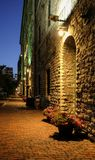 Night evening scene at Toronto Distillery District in summer time. Narrow cobblestone alley with flowers in pots. Night evening scene at Toronto Distillery stock photography