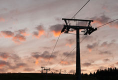 Night falls in the mountains with cableway. Royalty Free Stock Photo