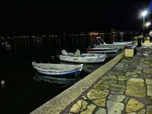 Night falls over the bay over the main town on the the Greek island of Corfu. The city of Corfu stands on the broad part of a peninsula, whose termination in the Royalty Free Stock Images