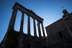 Night Falls on the Temple of Jupiter in the Ancient Forum in Rome Italy. Rome Italy, the Eternal city, which has been a destination for tourists since the times Stock Photos