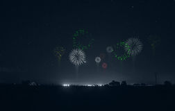 Night of feasts of the holidays with fireworks. Beautiful night in the city and fireworks Royalty Free Stock Image