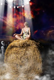 Night field fantasy. Woman taken from stack of hay by aliens Stock Photos