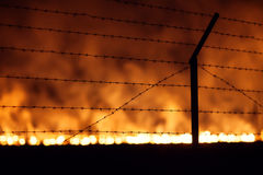 Night fire in a field Stock Photos
