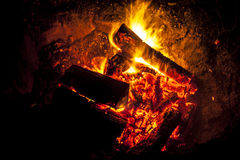 Night Fireplace. Orange and Red Fire Flames on Black Background royalty free stock photo