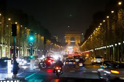 Night fires of cars on the Champs Elysee. Paris Royalty Free Stock Photos