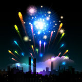 Night fireworks in a city. Fireworks over the Night City. Holiday or Celebration Time Royalty Free Stock Images