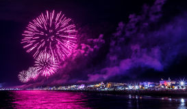 Night fireworks explosion on seafront. Rimini Notte Rosa. Festival Royalty Free Stock Image