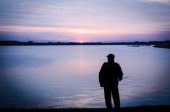 Night fisherman Stock Images
