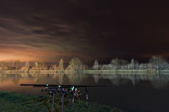 Night Fishing, Carp Rods, Cloudscape reflection on lake Royalty Free Stock Photos
