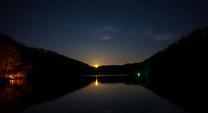 Night Fishing Under A Rising Full Moon. Royalty Free Stock Photography