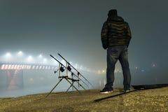 Night Fishing Urban Edition. Fisherman in Foggy night. Royalty Free Stock Photos
