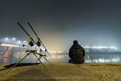 Night Fishing Urban Edition. Fisherman in Foggy night. Royalty Free Stock Image